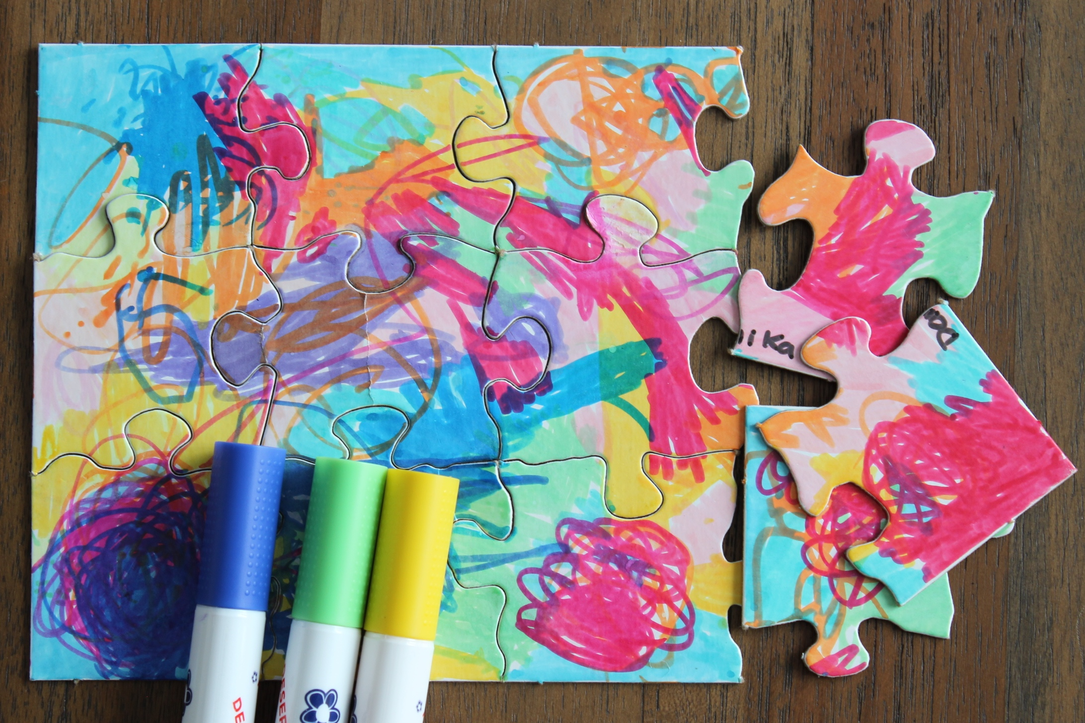Let your kids make their own totally unique puzzles with blank sheets of puzzle pieces and markers
