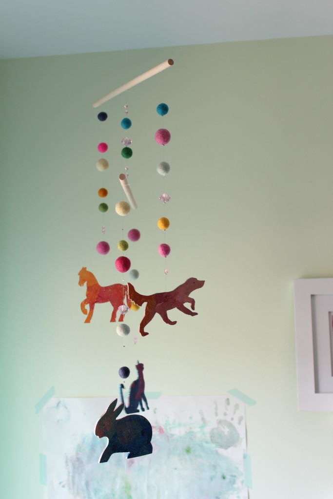 DIY mobile of wooden animal silhouettes for child's room. A collaborative project - Smocks & Shops
